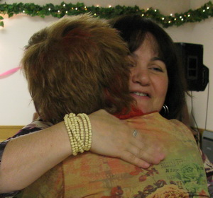 Getting a hug from my high school buddy, Patty.